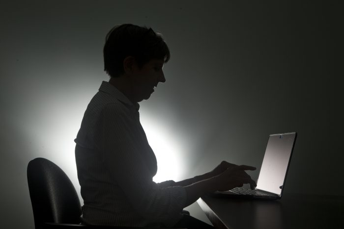 In this, Monday, Dec. 12, 2016, photo illustration, a woman types on her laptop, in Miami. Details from the Department of Justice indictment of Russian hackers on Wednesday, March 15, 2017, show that many people are still not taking routine precautions to safeguard their email accounts, and hackers are exploiting that. (AP Photo/Wilfredo Lee)