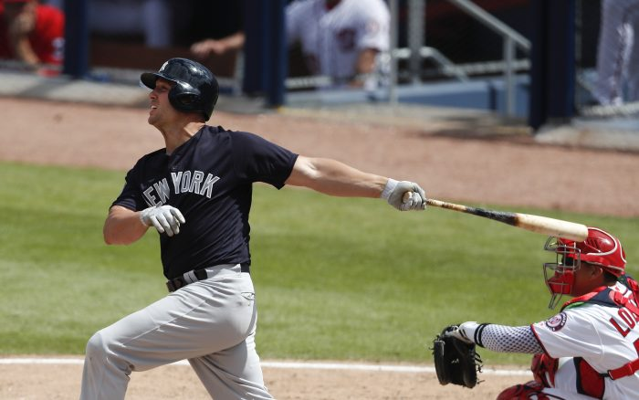 New York Yankees' Matt Holliday (17) follows through on a two-run homer as Washington Nationals catcher Jose Lobaton (59) looks on in fifth inning of a spring training baseball game Monday, March 20, 2017, in West Palm Beach, Fla. (AP Photo/John Bazemore)