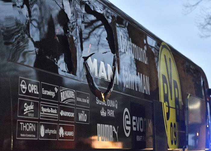 FILE - In this April 11, 2017 file photo a window of Dortmund's team bus is damaged after an explosion before the Champions League quarterfinal soccer match between Borussia Dortmund and AS Monaco in Dortmund, western Germany. (AP Photo/Martin Meissner, file)