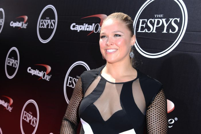 FILE - In this  July 15, 2015, file photo, Ronda Rousey arrives at the ESPY Awards at the Microsoft Theater in Los Angeles. Rousey announced her engagement to fellow MMA fighter Travis Browne on April 20, 2017. (Photo by Richard Shotwell/Invision/AP, File)