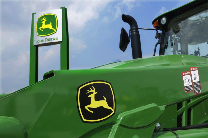 FILE - In this Monday, Aug. 31, 2015, file photo, John Deere equipment is on display at the Farm Progress Show in Decatur, Ill. Deere & Co. reports earnings, Friday, May 19, 2017. (AP Photo/Seth Perlman, File)