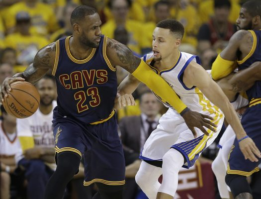FILE - In this June 2, 2016, file photo, Cleveland Cavaliers forward LeBron James (23) dribbles against Golden State Warriors guard Stephen Curry during the first half of Game 1 of basketball's NBA Finals in Oakland, Calif. While there have been 14 rematches in NBA Finals history, this year's meeting between LeBron James' Cleveland Cavaliers and Stephen Curry's Golden State Warriors will be the first trilogy in league history. (AP Photo/Marcio Jose Sanchez, File)