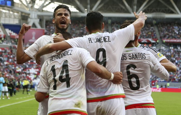 Mexico's Javier Hernandez , second from left, celebrates with teammates after scoring his side's first goal during the Confederations Cup, Group A soccer match between Portugal and Mexico, at the Kazan Arena, Russia, Sunday, June 18, 2017. (AP Photo/Martin Meissner)