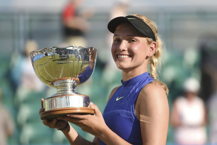 Croatia's Donna Vekic holds up the trophy after winning the women's final on day seven of the Nottingham Open at Nottingham Tennis Centre, England, Sunday June 18, 2017. ( Joe Giddens/PA via AP)