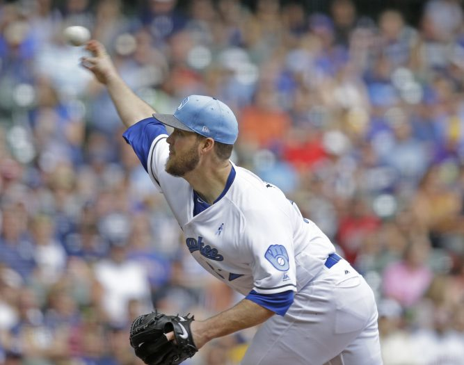 Milwaukee Brewers starting pitcher Jimmy Nelson throws to the San Diego Padres during the first inning of a baseball game, Sunday, June 18, 2017, in Milwaukee. (AP Photo/Jeffrey Phelps)