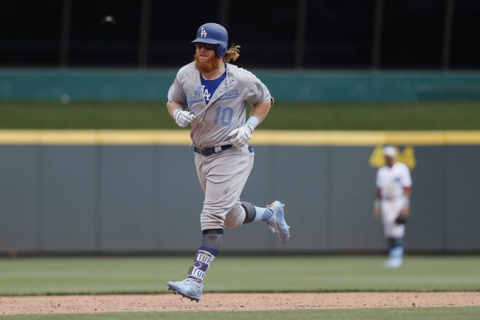 Los Angeles Dodgers' Justin Turner runs the bases after hitting a three-run home run off Cincinnati Reds relief pitcher Wandy Peralta in the sixth inning of a baseball game, Sunday, June 18, 2017, in Cincinnati. (AP Photo/John Minchillo)