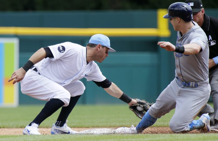 Tampa Bay Rays' Corey Dickerson, right, beats the tag from Detroit Tigers second baseman Ian Kinsler to steal second base during the third inning of a baseball game, Sunday, June 18, 2017, in Detroit. (AP Photo/Duane Burleson)