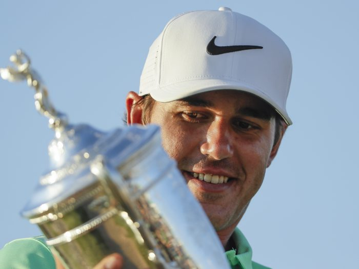 Brooks Koepka poses with the winning trophy after the U.S. Open golf tournament Sunday, June 18, 2017, at Erin Hills in Erin, Wis. (AP Photo/David J. Phillip)