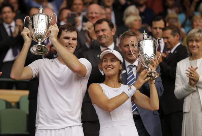 Britain's Jamie Murray and Switzerland's Martina Hingis celebrate as they hold their trophies after beating Finland's Henri Kontinen and Britain's Heather Watson to win the Mixed Doubles final match on day thirteen at the Wimbledon Tennis Championships in London Sunday, July 16, 2017. (AP Photo/Alastair Grant)