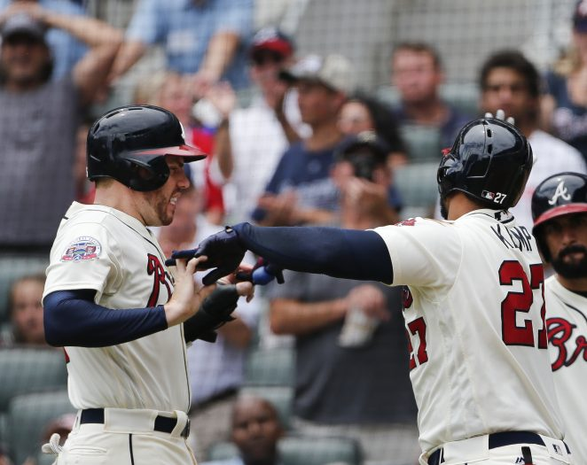 Atlanta Braves' Matt Kemp, front right, celebrates with Freddie Freeman, left, after hitting a three-run home run in the third inning of a baseball game against the Arizona Diamondbacks, Sunday, July 16, 2017, in Atlanta. (AP Photo/John Bazemore)