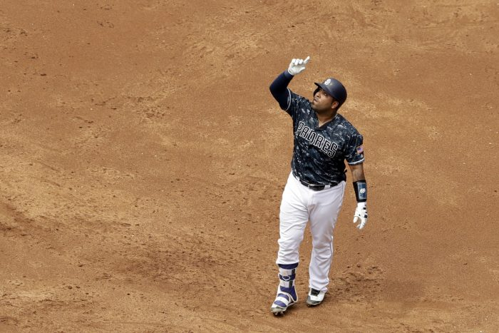 San Diego Padres' Hector Sanchez points skyward after hitting a single during the third inning of a baseball game against the San Francisco Giants, Sunday, July 16, 2017, in San Diego. (AP Photo/Gregory Bull)