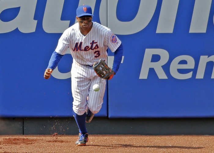 New York Mets center fielder Curtis Granderson (3) chases down Colorado Rockies' Charlie Blackmon's seventh-inning two-run home run in a baseball game Sunday, July 16, 2017, in New York. (AP Photo/Kathy Willens)