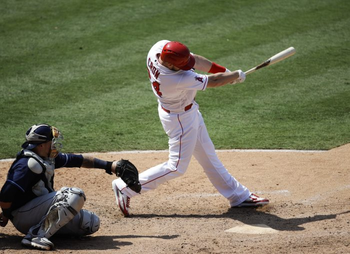 Los Angeles Angels' C.J. Cron, riht, hits a two-run home run during the eighth inning of a baseball game against the Tampa Bay Rays, Sunday, July 16, 2017, in Anaheim, Calif. (AP Photo/Jae C. Hong)