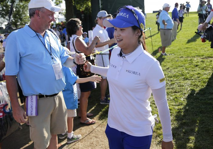 South Korea's Hye-Jin Choi is greeted by fans and tournament volunteers as she walks to the 16th tee during the final round of the U.S. Women's Open Golf tournament Sunday, July 16, 2017, in Bedminster, N.J. (AP Photo/Seth Wenig)