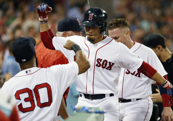Boston Red Sox's Mookie Betts, center, celebrates his two-run home run during the third inning of the second game of a baseball doubleheader against the New York Yankees in Boston, Sunday, July 16, 2017. (AP Photo/Michael Dwyer)