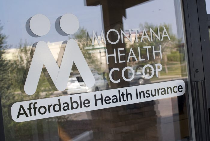 This Friday, Aug. 11, 2017 photo shows the offices of the Montana Health Co-op in Helena, Mont. The Montana Health Co-op resumes accepting new enrollees on Sunday, Aug. 13, 2017 after withdrawing from the state's health insurance exchange last year amid worries about its financial health. Chief Executive Officer Jerry Dworak asserts that the co-op is in position to absorb all 64, 000 Montanans who buy policies from the state's health insurance exchange. (AP photo/Bobby Caina Calvan)