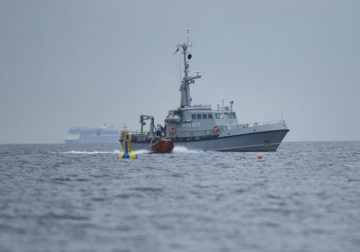 Danish maritime authorities work on a salvage operation, taking place in connection with a criminal investigation, south of the island of Amager close to Copenhagen, Denmark, Saturday, Aug. 12, 2017.  Danish prosecutors urged a judge on Saturday to hold in pre-trial detention the owner of an amateur-built submarine, suspected of being responsible for the disappearance of a Swedish woman who had been onboard the ship that later sank. The buoy marks where privately built and owned submarine UC3 Nautilus sank. (Brian Lindberg Jensen/Ritzau Foto via AP)