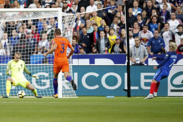 Netherlands'goalkeeper Jasper Cillessen, left, misses to save to the goal from France's Antoine Griezmann, right, as Netherlands' Stefan de Vrij looks on during the World Cup Group A qualifying soccer match between France and The Netherlands at the Stade de France stadium in Saint-Denis, outside Paris, Thursday, Aug.31, 2017. (AP Photo/Christophe Ena)