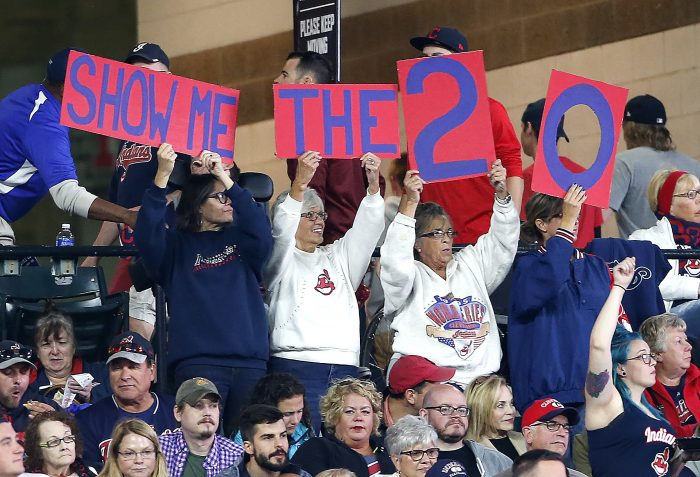 Cleveland Indians fans cheer for their team to win their 20th straight game during the fourth inning in a baseball game against the Detroit Tigers, Tuesday, Sept. 12, 2017, in Cleveland. (AP Photo/Ron Schwane)