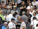 Baseball fans reacts as a young girl is carried out of the seating area after being hit by a line drive during the fifth inning of a baseball game between the New York Yankees and Minnesota Twins, Wednesday, Sept. 20, 2017, at Yankee Stadium in New York. (AP Photo/Bill Kostroun)
