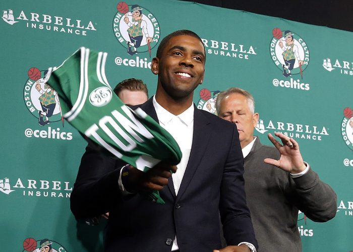 FILE - In this Friday, Sept. 1, 2017, file photo, Boston Celtics' Kyrie Irving leaves a news conference in Boston. When Irving approached Cavs owner Dan Gilbert and asked to be traded so he could get out of James' shadow, it set in motion a series of events that couldn't have been imagined. (AP Photo/Winslow Townson, File)
