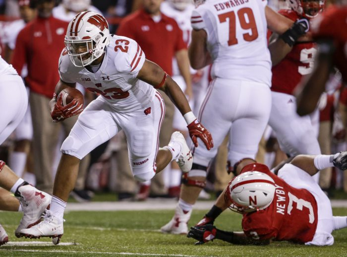 FILE - In this Oct. 7, 2017, file photo, Wisconsin running back Jonathan Taylor (23) carries the ball past Nebraska linebacker Marcus Newby (3) during the second half of an NCAA college football game in Lincoln, Neb. Taylor is fourth in the country in rushing at 153.4 yards per game, exhibiting balance, speed and tackle-breaking talent. (AP Photo/Nati Harnik, File)