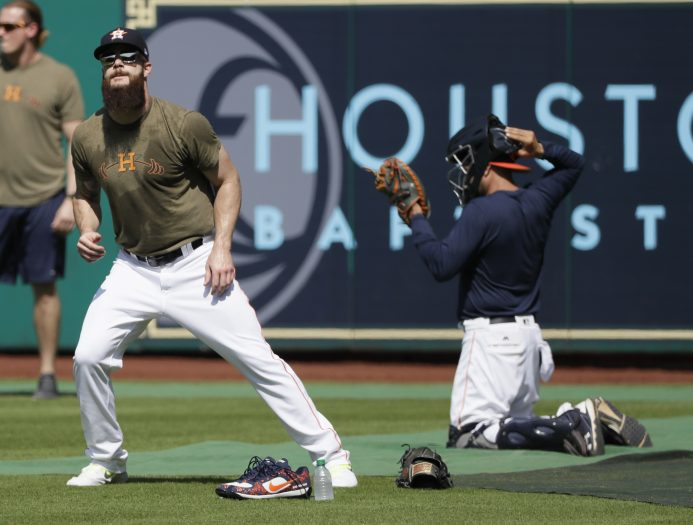 Houston Astros' Houston Astros' Dallas Keuchel warms up during batting practice for Game 1 of the American League Championship Series baseball game against the New York Yankees Thursday, Oct. 12, 2017, in Houston. (AP Photo/David J. Phillip)