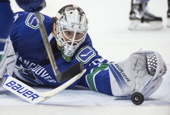 Vancouver Canucks' goalie Jacob Markstrom, of Sweden, releases the puck from his glove after making a save against the Winnipeg Jets during the third period of an NHL hockey game in Vancouver, British Columbia, Thursday, Oct. 12, 2017. (Darryl Dyck/The Canadian Press via AP)