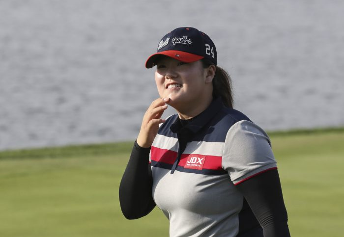 Angel Yin of the United States smiles after finishing the second round of the LPGA KEB HanaBank Championship at Sky72 Golf Club in Incheon, South Korea, Friday, Oct. 13, 2017. (AP Photo/Lee Jin-man)