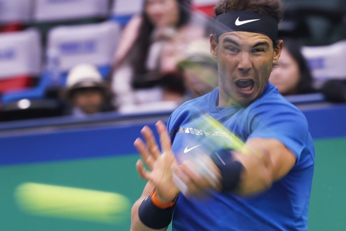 Rafael Nadal of Spain hits a return shot against Grigor Dimitrov of Bulgaria during their men's quarterfinals match in the Shanghai Masters tennis tournament at Qizhong Forest Sports City Tennis Center in Shanghai, China, Friday, Oct. 13, 2017. (AP Photo/Andy Wong)