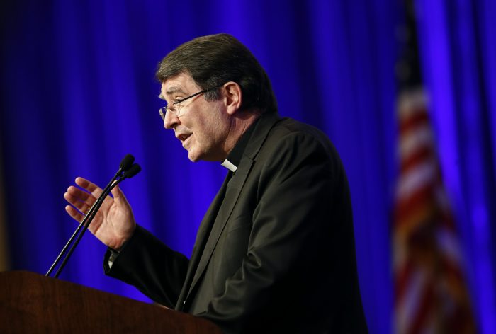 Archbishop Christophe Pierre, Apostolic Nuncio to the United States, delivers remarks at the United States Conference of Catholic Bishops' annual fall meeting in Baltimore, Monday, Nov. 13, 2017. (AP Photo/Patrick Semansky)