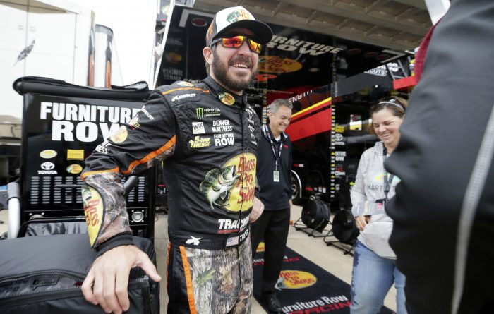 Martin Truex Jr. stands in the garage area before practice for Sunday's NASCAR Cup series auto race at Texas Motor Speedway in Fort Worth, Texas, Friday, Nov. 3, 2017. (AP Photo/LM Otero)