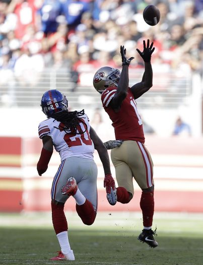 San Francisco 49ers wide receiver Marquise Goodwin (11) catches a touchdown pass in front of New York Giants cornerback Janoris Jenkins (20) during the first half of an NFL football game in Santa Clara, Calif., Sunday, Nov. 12, 2017. (AP Photo/Marcio Jose Sanchez)