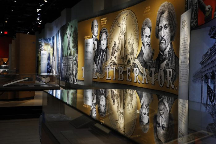 An exhibit discussing slavery and the Bible in the United States is displayed inside the Museum of the Bible, Monday, Oct. 30, 2017, in Washington. The museum was built by the owners of Hobby Lobby, cost $500 million to build, covers 430,000 square feet and is a few blocks from the U.S. Capitol.(AP Photo/Jacquelyn Martin)
