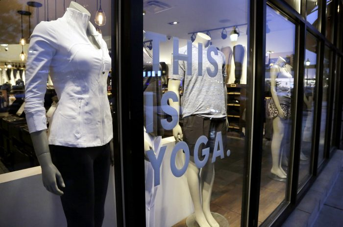 In this Monday, June 5, 2017, photo, Lululemon Athletica apparel is displayed on mannequins in a storefront at a Lululemon Athletica store location in Dedham, Mass. Lululemon Athletica Inc. reports earnings Wednesday, Dec. 6, 2017. (AP Photo/Steven Senne)