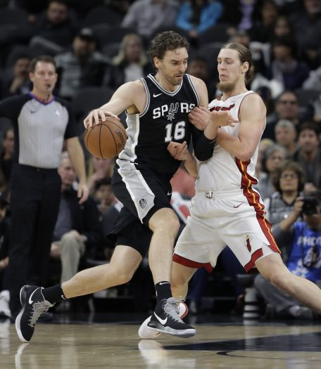 San Antonio Spurs center Pau Gasol (16) drives around Miami Heat center Kelly Olynyk during the first half of an NBA basketball game Wednesday, Dec. 6, 2017, in San Antonio. (AP Photo/Eric Gay)