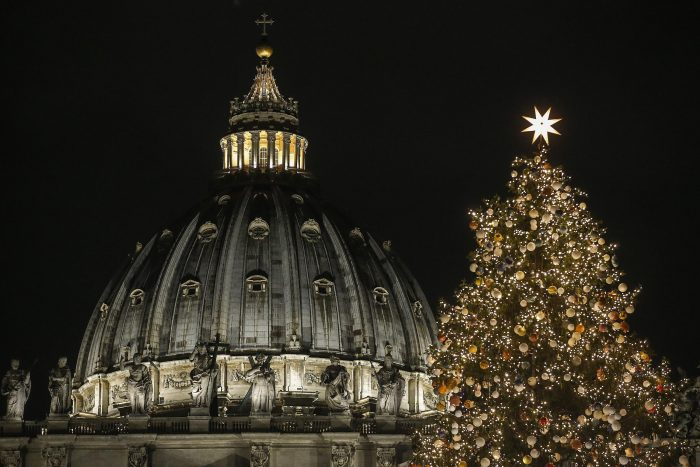 A 21 meters (69 feet) high Christmas tree coming from Poland is backdropped by the dome of St. Peter's Basilica, at the Vatican, Thursday, Dec. 7, 2017. (Fabio Frustaci/ANSA via AP)