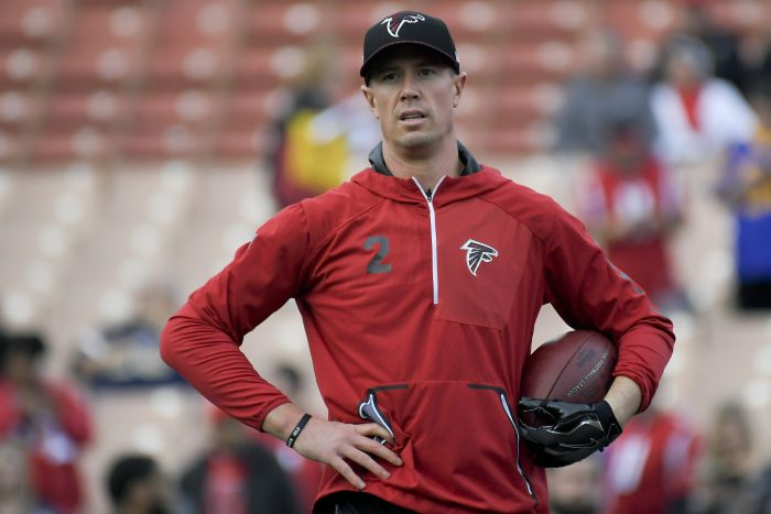 FILE - In this Jan. 6, 2018, file photo, Atlanta Falcons quarterback Matt Ryan watches during warm ups before an NFL wild-card playoff football game against the Los Angeles Rams, in Los Angeles. After missing practice on Tuesday, Jan. 9, 2018, for undisclosed personal reasons, Falcons quarterback Matt Ryan is expected back on Wednesday. It's an important practice day as Atlanta prepares for Saturday's divisional round playoff game at Philadelphia. (AP Photo/Mark J. Terrill, File)