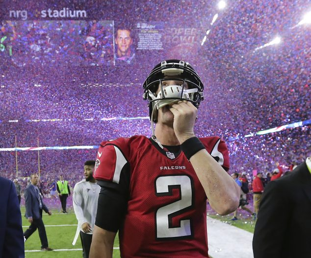 FILE - In this photo taken Feb. 5, 2017, file photo, Atlanta Falcons quarterback Matt Ryan reacts after losing Super Bowl 51 as the screen flashes New England Patriots quarterback Tom Brady and confetti flies in Houston. The Falcons' biggest disappointment was their blowing of a 25-point lead in last year's Super Bowl. (Curtis Compton/Atlanta Journal-Constitution via AP, File)