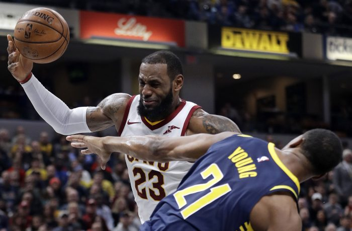 Cleveland Cavaliers' LeBron James (23) is fouled by Indiana Pacers' Thaddeus Young as he goes up to shoot during the first half of an NBA basketball game, Friday, Jan. 12, 2018, in Indianapolis. (AP Photo/Darron Cummings)