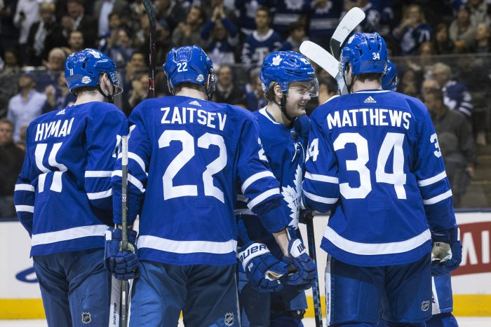 Toronto Maple Leafs center William Nylander (29) celebrates with centre Zach Hyman (11) defenseman Nikita Zaitsev (22) centre Auston Matthews (34) and Jake Gardiner (obscured) after scoring against the Tampa Bay Lightning during second period NHL hockey action in Toronto on Monday, Feb. 12, 2018. (Chris Young/The Canadian Press via AP)