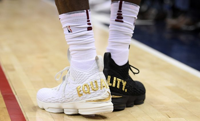 "FILE - In this Dec. 17, 2017, file photo, Cleveland Cavaliers forward LeBron James' shoes are emblazoned with ""EQUALITY"" on both heels during the first half of an NBA basketball game against the Washington Wizards, in Washington. When LeBron James stepped on the court wearing mismatched sneakers in the nation's capital, it wasn't a fashion statement by the NBA's most popular athlete. The message was clearly emblazed in gold on the back of his kicks. Sneaker enthusiasts around the world eagerly await NBA All-Star weekend when new and limited editions of the latest shoes make their debut, but the month leading up to highly anticipated shoe palooza is a time often used to make a social statement.(AP Photo/Nick Wass, File)"