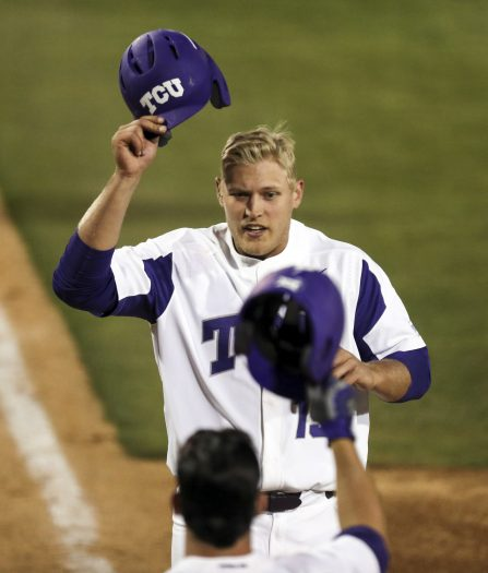 FILE - In this March 24, 2017, file photo, TCU's Luken Baker is greeted at the plate by Josh Watson after a solo home run in the eighth inning against Oklahoma State during an NCAA college baseball game in Fort Worth, Texas. The Horned Frogs head into the 2018 baseball season looking to become the first program to make five straight College World Series appearances since the NCAA went to its current tournament format in 1999.(Richard W. Rodriguez/Star-Telegram via AP, File)