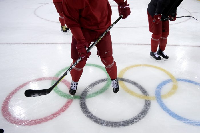 Hockey athletes of the team from Russia skate by the Olympic rings during a training session at the 2018 Winter Olympics in Gangneung, South Korea, Monday, Feb. 12, 2018. (AP Photo/Julio Cortez)