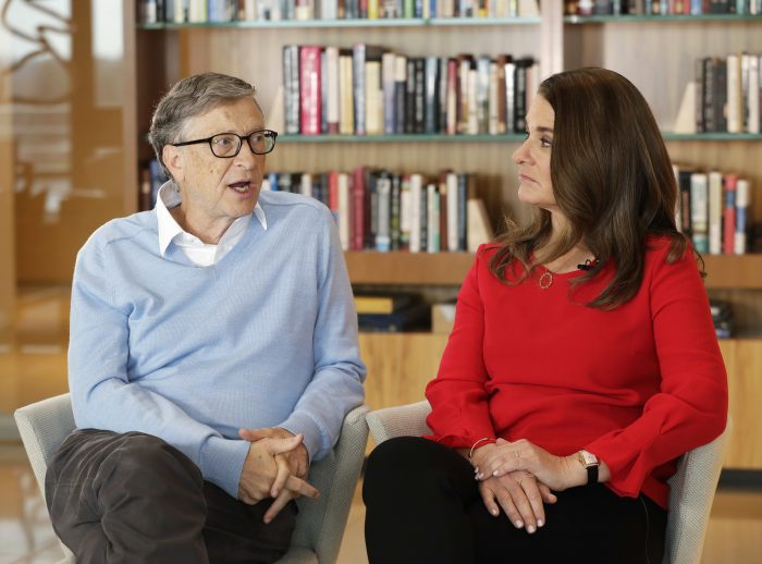 In this Feb. 1, 2018 photo, Microsoft co-founder Bill Gates and his wife Melinda take part in an interview with The Associated Press in Kirkland, Wash. Gates and his wife, head the Bill and Melinda Gates Foundation, are rethinking their work in America as they confront what they consider an unsatisfactory track record, the country's growing inequity and a president they disagree with more than any other. (AP Photo/Ted S. Warren)
