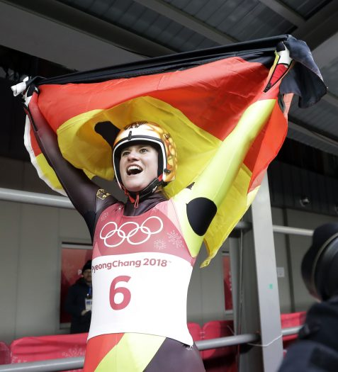 Natalie Geisenberger of Germany celebrates her gold medal win the finish area after the women's luge final at the 2018 Winter Olympics in Pyeongchang, South Korea, Tuesday, Feb. 13, 2018. (AP Photo/Wong Maye-E)