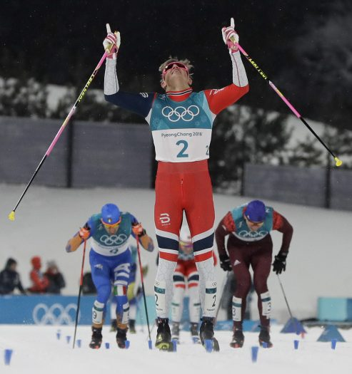Johannes Hoesflot Klaebo, of Norway, celebrates after winning the men's cross-country skiing sprint classic at the 2018 Winter Olympics in Pyeongchang, South Korea, Tuesday, Feb. 13, 2018. (AP Photo/Kirsty Wigglesworth)