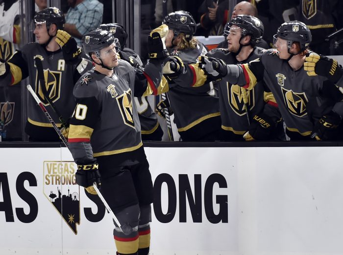 Vegas Golden Knights center Ryan Carpenter (40) celebrates with his team after scoring against the Chicago Blackhawks during the first period of an NHL hockey game Tuesday, Feb. 13, 2018, in Las Vegas. (AP Photo/David Becker)