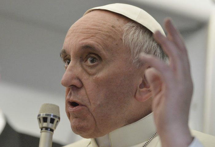 FILE - In this July 29, 2013 file phtoo, Pope Francis talks about gays saying he wouldn't judge priests for their sexual orientation in a remarkably open and wide-ranging news conference aboard the papal flight on the journey back from Brazil. Francis' humble sense of empathy him admirers around the globe but as he marks his 5th anniversary Tuesday, March 13, 2018, criticism is growing for the merciful causes he has embraced, and those he has neglected.  (AP Photo/Luca Zennaro, Pool, file)
