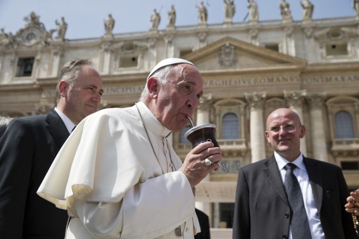 "FILE - In tis April 6, 2016 file photo, Pope Francis drinks from a mate gourd at the end of his weekly general audience, in St. Peter's Square at the Vatican. Tuesday, March 13, 2018 marks five years of Pope Francis' pontificate, in these five years, the world has gotten to know Jorge Mario Bergoglio, the son of Italian immigrants to Argentina who was so self-deprecating that when he emerged on the loggia of St. Peter's Basilica on March 13, 2013, as Pope Francis, he quipped that his brother cardinals had to search to the ""end of the Earth"" to find a new leader.  (AP Photo/Andrew Medichini, file)"